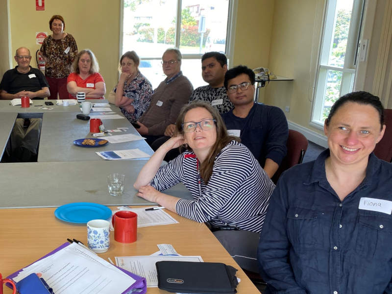 Happy participants in a brain injury workshop